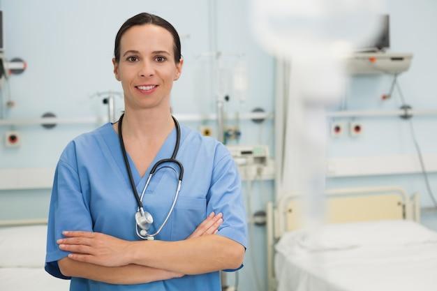 Smiling nurse in hospital ward