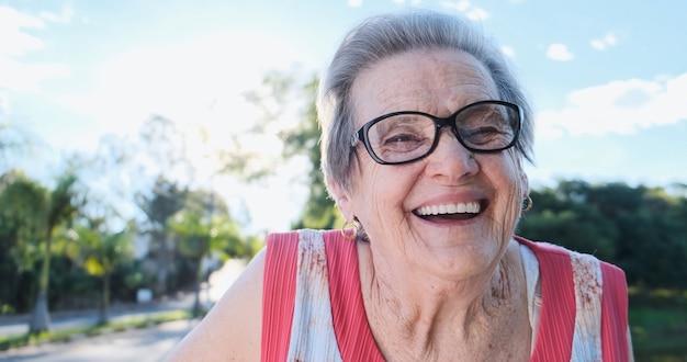 Smiling old latin woman beautiful senior woman looking at the camera