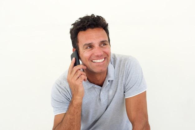 Smiling older man talking on mobile phone