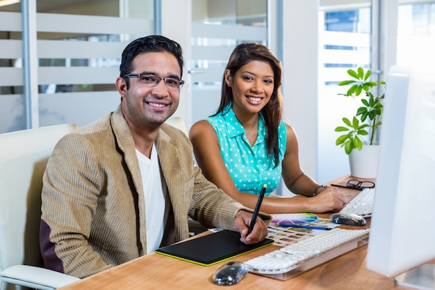 Smiling partners working together on digitizer