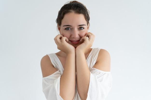 Smiling pretty woman posing at camera
