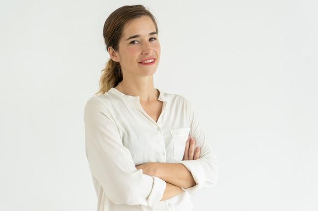 Smiling pretty young woman posing at camera