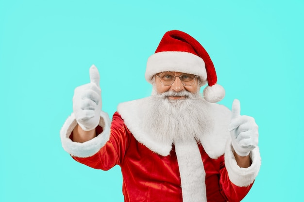 Smiling santa claus showing thumbs up.
