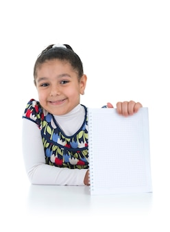 Smiling schoolgirl with homework done on white background