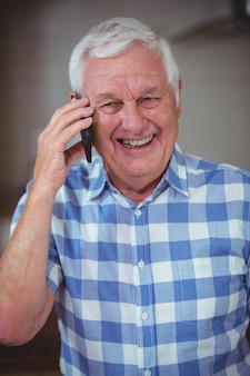 Smiling senior man talking on phone
