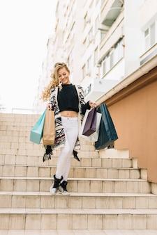 Smiling shopper walking downstairs