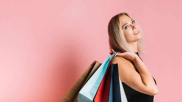 Smiling shopper with colorful bags