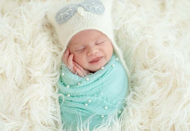 Smiling sleeping newborn kid