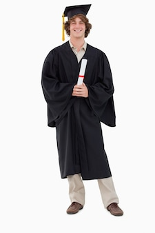 Smiling student in graduate robe