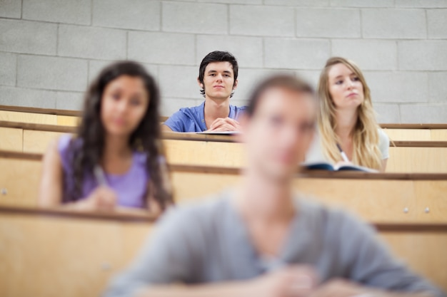 Smiling students listening during a lecture
