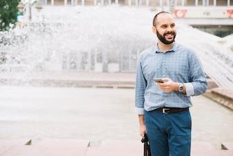 Smiling stylish man posing at street