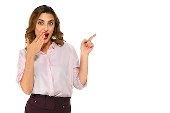Smiling surprised businessman presenting copy space, covering her mouth with finger