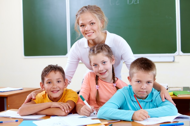 Smiling teacher with students