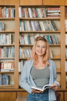 Smiling teenager with book
