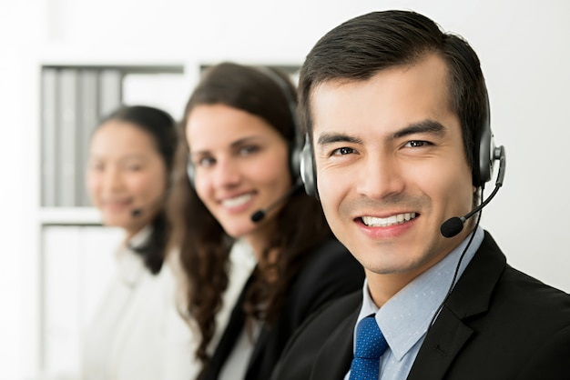 Smiling telemarketing customer service agent team, call center job concept