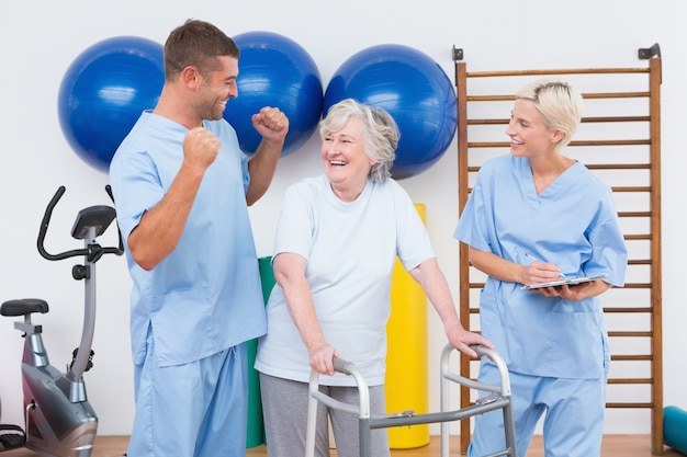 Smiling therapists with invalid woman