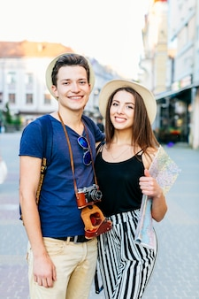 Smiling tourist couple in city