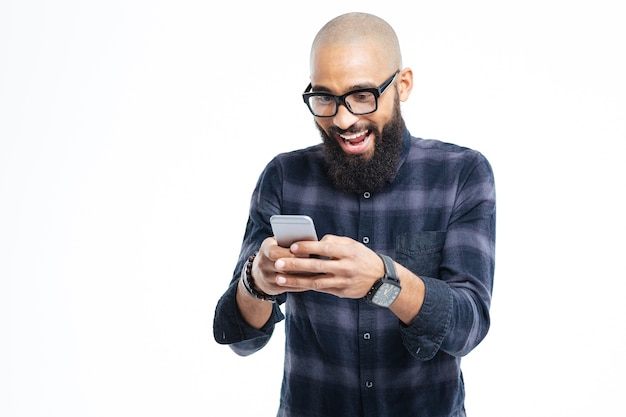 Smiling and using mobile phone