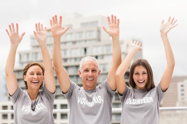 Smiling volunteers cheering
