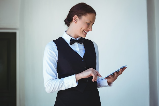 Smiling waitress using a tablet