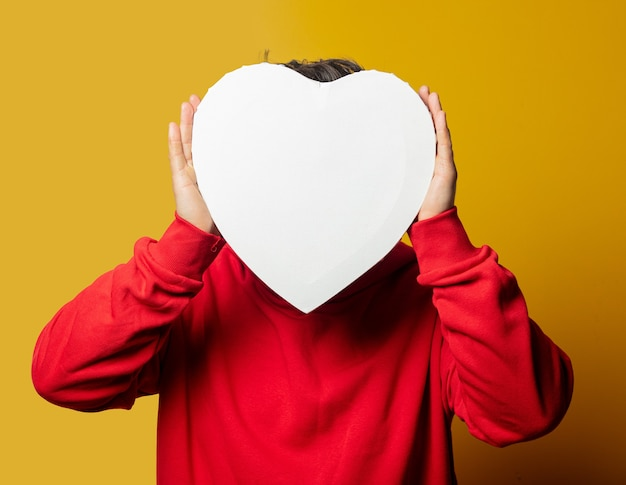 Smiling white guy in red sweatshirt with heart shape mockup