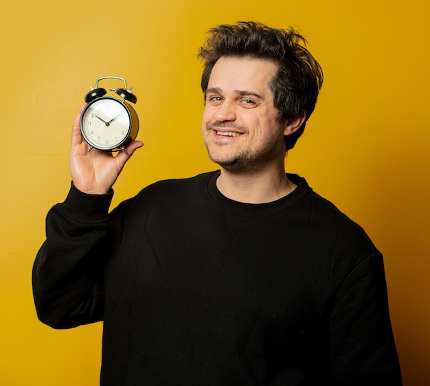 Smiling white guy with alarm clock