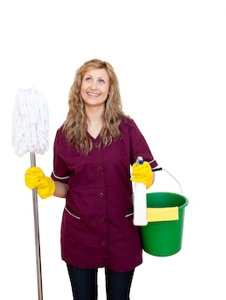 Smiling with cleaning utensils