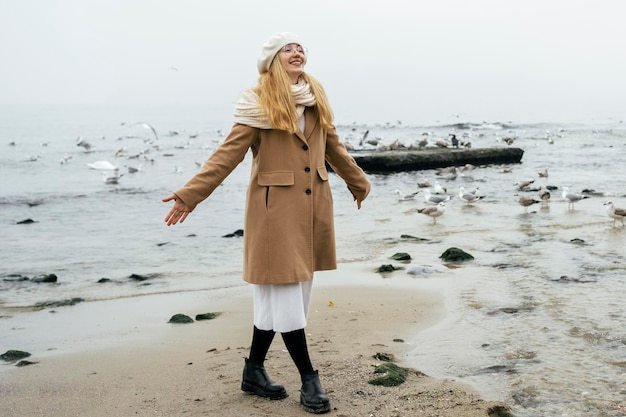Smiling woman at the beach in winter