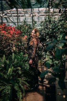 Smiling woman in the botanic garden