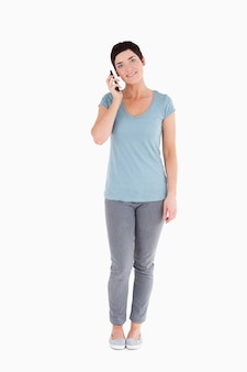 Smiling woman calling with a mobile phone
