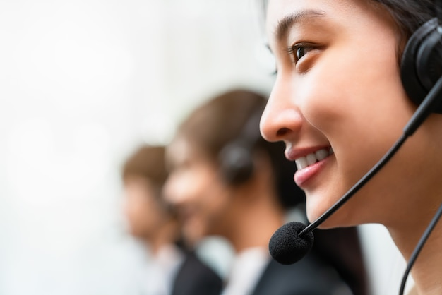 Smiling woman consultant wearing microphone headset at workplace.