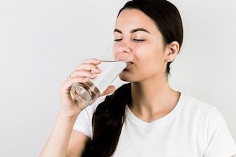 Smiling woman drinking water