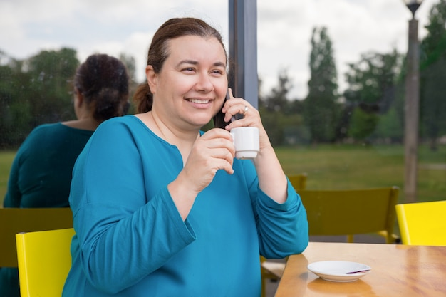 Smiling woman enjoying phone talk
