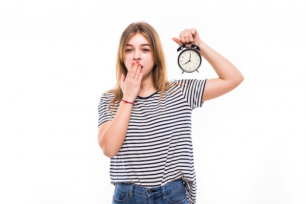 Smiling woman in eyeglasses holding alarm clock