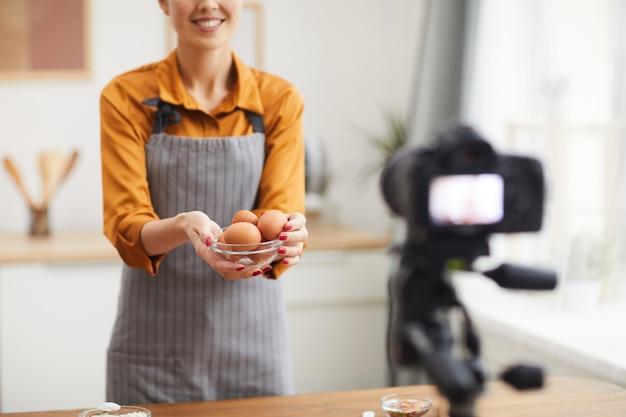 Smiling woman filming baking video