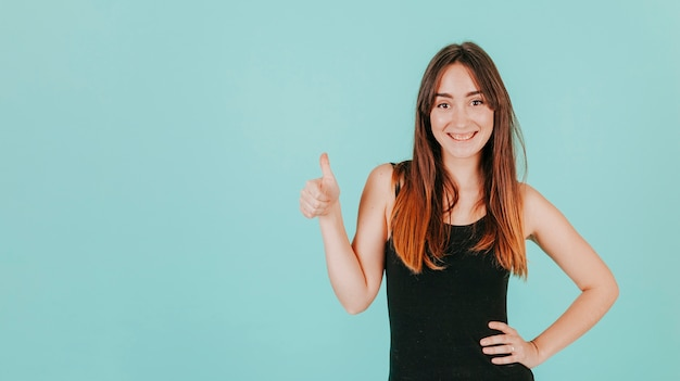 Smiling woman gesturing thumb-up