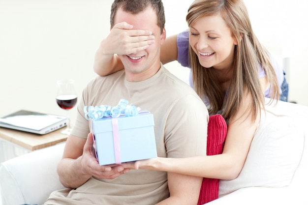 Smiling woman giving a present to her boyfriend