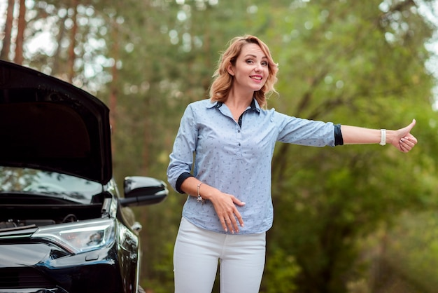 Smiling woman hitchhiking