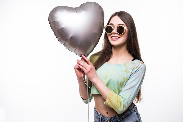 Smiling woman holding heart balloon.