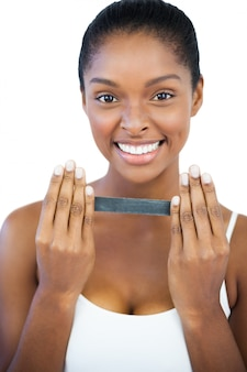 Smiling woman holding nail file