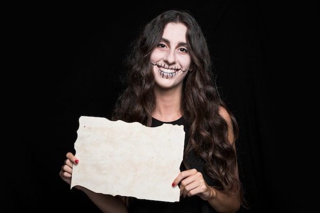 Smiling woman holding paper
