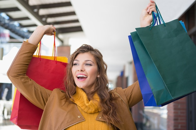Smiling woman holding shopping bags