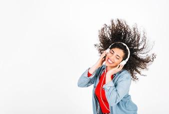 Smiling woman in headphones shaking hair