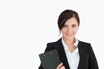 Smiling woman in suit holding a clipboard