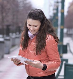 Smiling woman looking at digital tablet screen