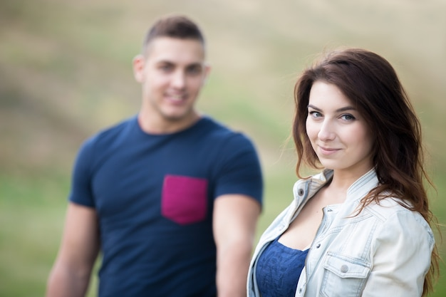 Smiling woman and man unfocused