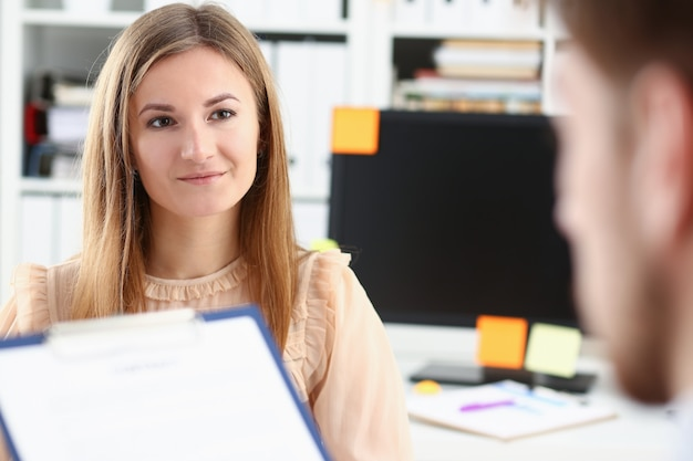 Smiling woman offer contract form