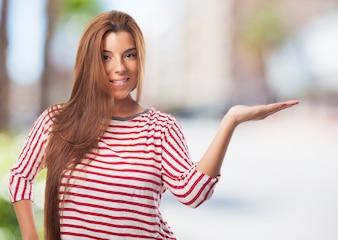 Smiling woman palms up displaying something.