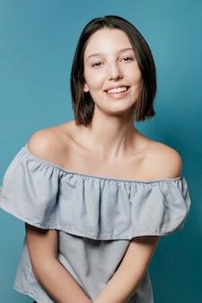 Smiling woman posing in ruffle top