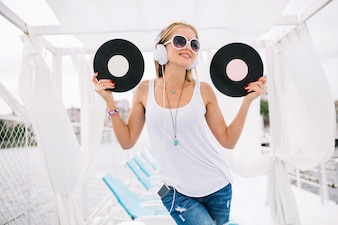 Smiling woman posing with vinyls